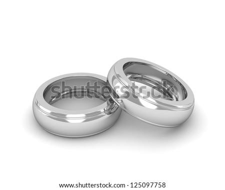 Elegant white gold wedding rings isolated on white background - stock photo