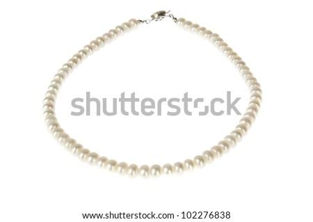 Elegant white pearl necklace isolated on white - stock photo