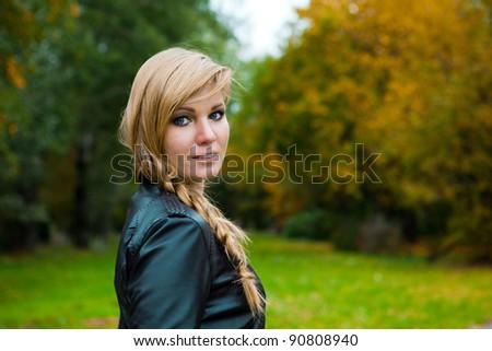 elegant woman in a landscape - stock photo