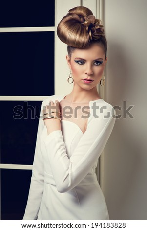 elegant woman in white dress with creative hairstyle  - stock photo