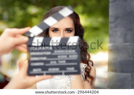 Elegant Woman Ready for a Shoot - Young actress ready to film a new scene   - stock photo