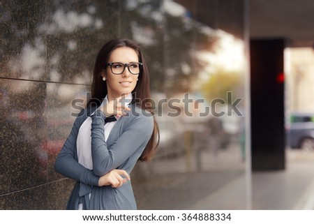 Elegant Woman Wearing Glasses Standing Out in The City - Portrait of a beautiful businesswoman wearing eyeglasses  - stock photo