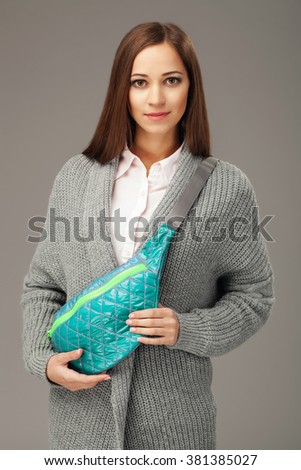 Elegant woman with a fanny pack
