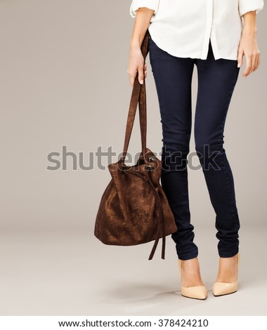 Elegant woman with a fashion bag - stock photo