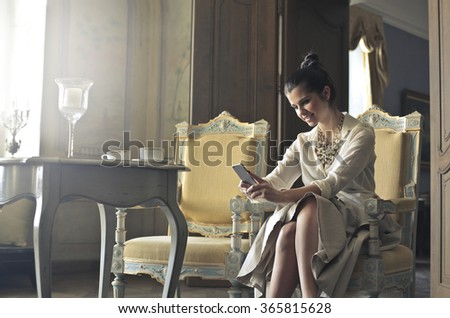 Elegant woman with a pleased expression - stock photo