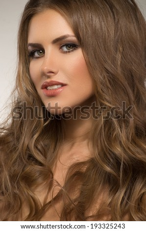 Elegant woman with beautiful skin and healthy hair