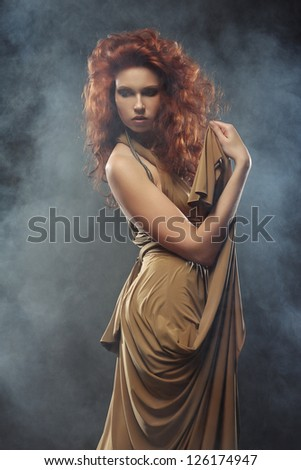 elegant woman with bright red curly hair