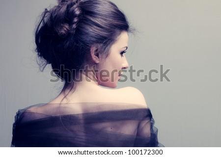 elegant woman with bun, back view profile, studio shot - stock photo