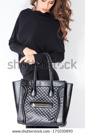 elegant woman with handbag - stock photo