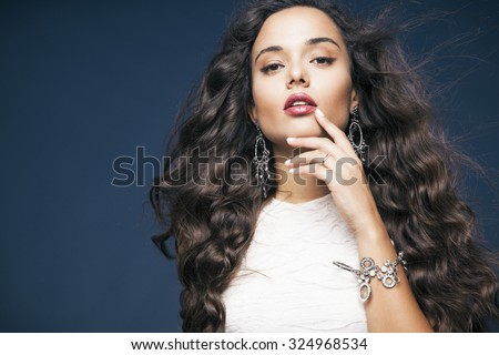 Elegant woman with long wavy hair and red lips wearing white dress . Fashion and beauty  concept, studio shot, Horizontal - stock photo