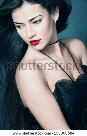 elegant woman with red lips and dark long hair beauty portrait studio shot  - stock photo
