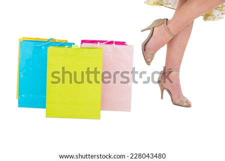 Elegant woman with shopping bags on white background