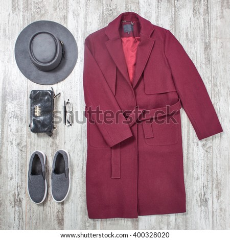 elegant women clothes and accessories on a wooden background, raspberry coat - stock photo