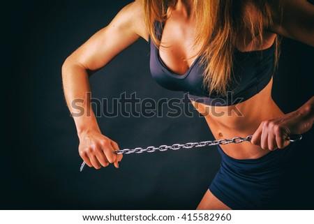 Elegant women trained body on black. Women's fitness - stock photo
