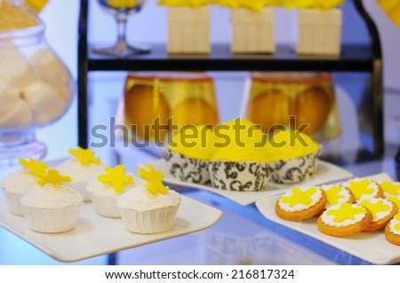 Elegant yellow sweet table on wedding or event party  - stock photo