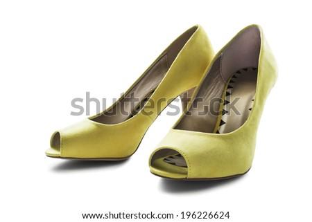 Elegant yellow textile high heeled shoes isolated over white - stock photo