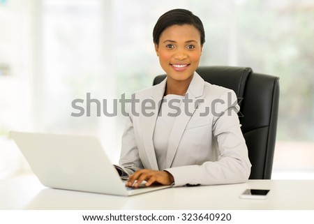 elegant young african american businesswoman in modern office
