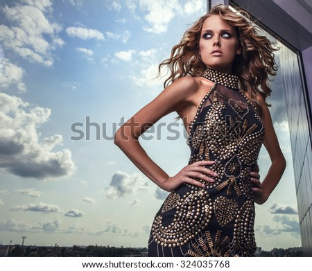 Elegant young beauty woman in luxury dress posing indoor. Fashion photo.  - stock photo