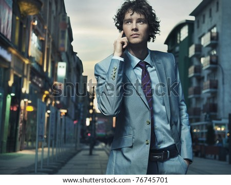 Elegant young businessman talking over cellphone