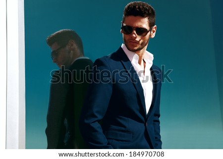 Elegant young handsome business man wearing glasses and watchers.  - stock photo