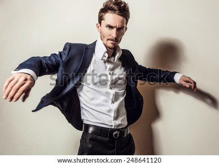 Elegant young handsome man in classic costume. Studio fashion portrait. - stock photo