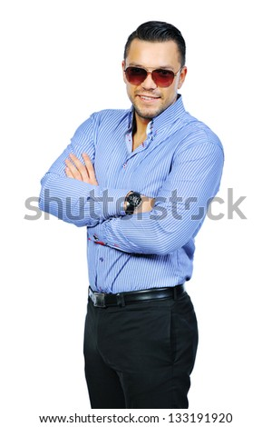 Elegant young handsome man in sunglasses - portrait - stock photo