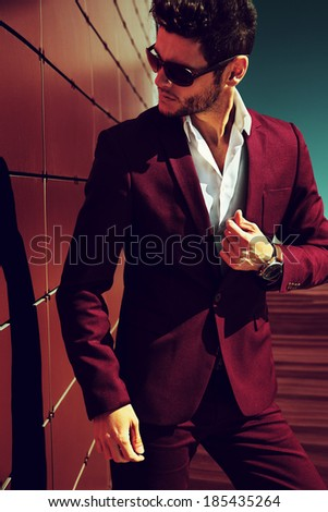 Elegant young handsome man. Outdoors fashion portrait. Man with glasses. - stock photo