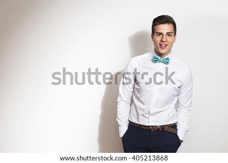 Elegant young handsome man  Studio fashion portrait. Copy space. Depth of field, selective focus  - stock photo
