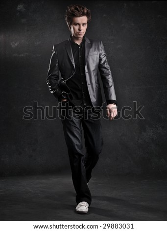 Elegant young handsome man walking - stock photo
