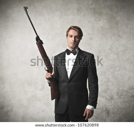 Elegant young killer holding a sniper - stock photo