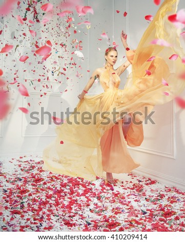 Elegant young lady in a white room - stock photo