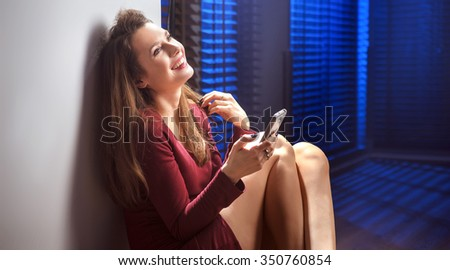 Elegant young lady using smartphone - stock photo
