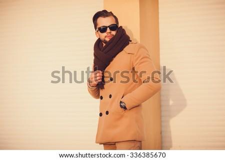 elegant young man. fashion portrait outdoors - stock photo