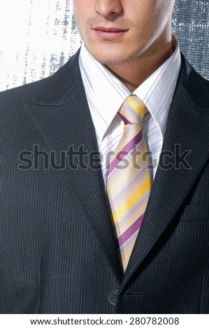 Elegant young man in the suit - stock photo