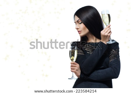 Elegant young woman in evening dress with glass of champagne - stock photo