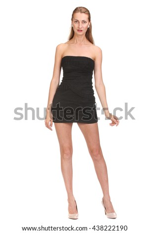 Elegant young woman in short little dress looking at camera. Isolated on white background.