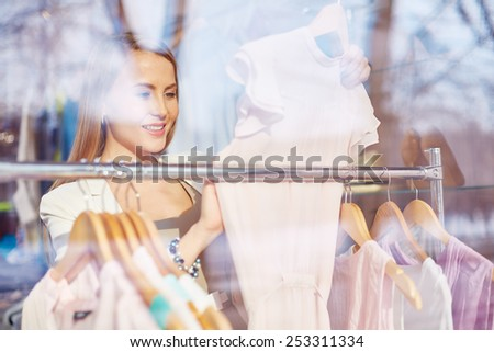 Elegant young woman shopping in boutique - stock photo