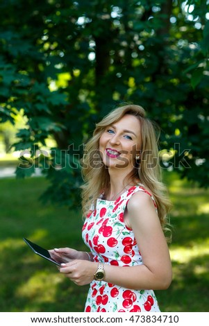 Elegant young woman  using tablet. Smile.Happy woman.