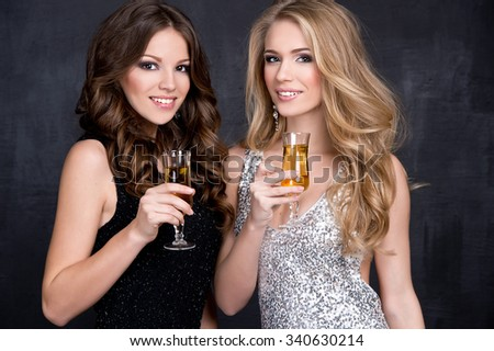 Elegant young women with a champagne glasses at celebration - stock photo