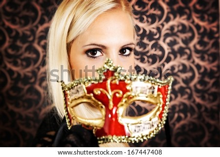 Elegantly dressed light hair model wearing a mask. - stock photo