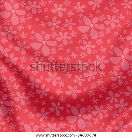 Elegantly flowing satin fabric with little flowers in pink, beige, red - stock photo