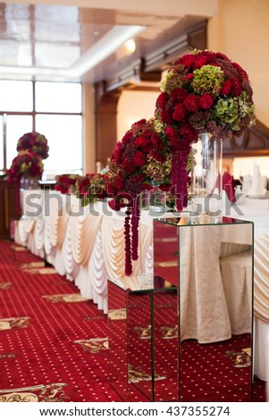 elegantly stylishly luxuriantly decorated with beautifully flowers restaurant for celebration