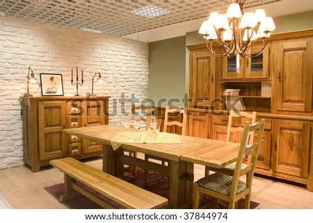 Elegnat dining room with wooden furniture.
