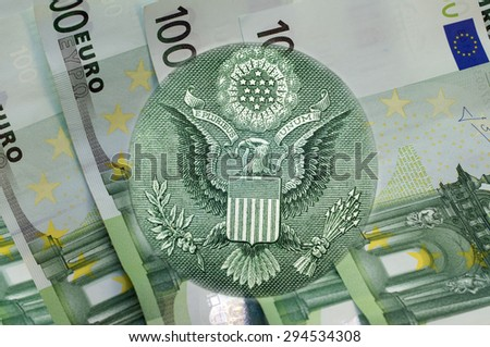 Element of the image of United States one-dollar bill, eagle above one hundred euros banknotes. Conceptual photo for your successful business design. Macro - stock photo