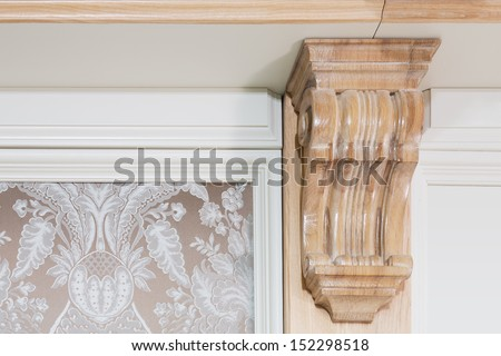 Element of wall decor near the ceiling - a decorative wooden ornament in a classic style - stock photo
