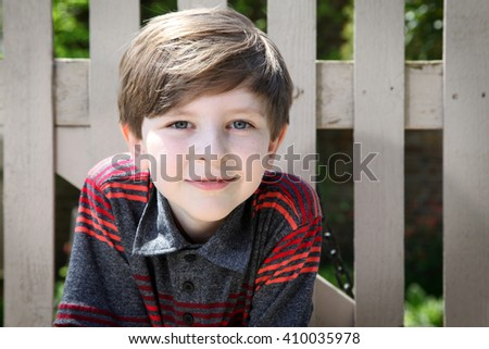 Elementary aged schoolboy - stock photo