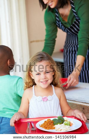 Elementary Pupil Collecting Healthy Lunch In Cafeteria - stock photo