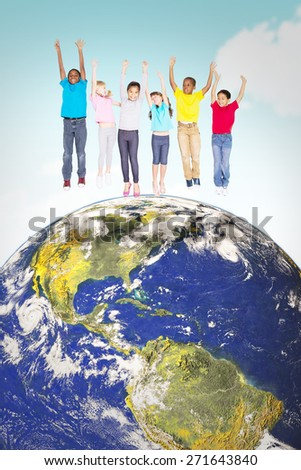 Elementary pupils jumping against blue sky - stock photo