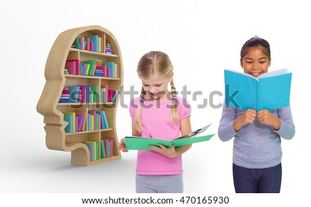 Elementary pupils reading against colorful books in human face bookshelves
