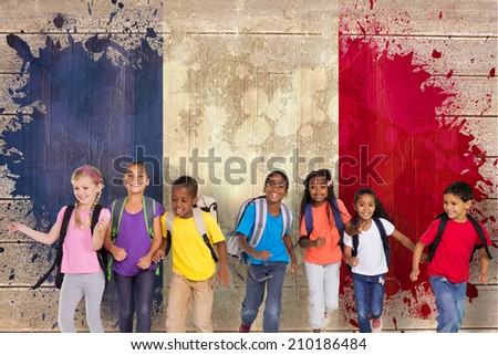 Elementary pupils running against france flag in grunge effect - stock photo